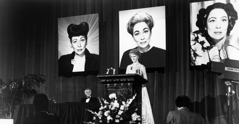 MOMMIE DEAREST, Diana Scarwid (at podium), Faye Dunaway (in photographs), 1981, (c) Paramount