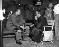 THE LEFT HAND OF GOD, director Edward Dmytryk, Humphrey Bogart, on-set, 1955, TM and Copyright (c) 20th Century Fox Film Corp. All rights reserved.