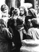 THE LAST TEMPTATION OF CHRIST, Willem Dafoe, Verna Bloom, with children, 1988. ©Universal Pictures.