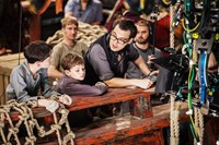PAN, from left: Lewis MacDougall, Levi Miller, director Joe Wright, on set, 2015. ph: Laurie Sparham/©Warner Bros. Pictures
