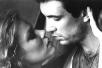 HARDWARE, from left: Stacey Travis, Dylan McDermott, 1990, ©Millimeter Films