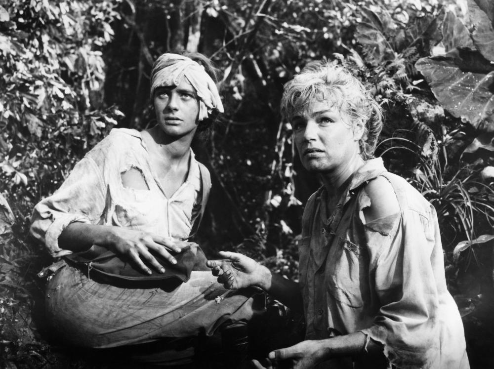 DEATH IN THE GARDEN, (aka LE MORT EN CE JARDIN, aka THE DIAMOND HUNTERS, aka EVIL EDEN, aka GINA), from left: Michele Girardon, Simone Signoret, 1956