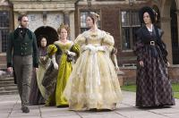 THE YOUNG VICTORIA, Mark Strong (left), Miranda Richardson (left of center), Emily Blunt, as Victoria (right of center), 2009. ©Momentum Pictures