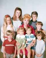 YOURS, MINE AND OURS, center: Lucille Ball; top 4 from left: Kimberly Beck, Jennifer Leak, Kevin Burchett, Mitch Vogel; bottom 4 from left: Eric Shea, Lynnell Atkins, Greg Atkins, Morgot Jane, 1968
