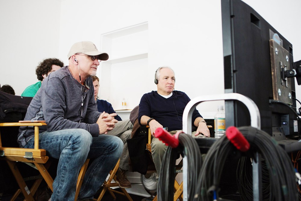 WHISKEY TANGO FOXTROT, foreground from left: producers Ian Bryce, Lorne Michaels, on set, 2016. ph: Frank Masi/© Paramount Pictures