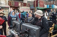 WHISKEY TANGO FOXTROT, foreground from left: Tina Fey, directors Glenn Ficarra, John Requa, on set, 2016. ph: Frank Masi/© Paramount Pictures