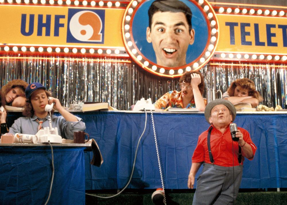 UHF, David Bowe (front left), Weird Al Yankovic (back ,center), Michael Richards (above, in poster), Billy Barty (front right), Victoria Jackson (back right), 1989. ©Orion Pictures