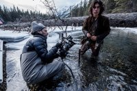 THE REVENANT, from left: cinematographer Emmanuel Lubezki, Forrest Goodluck, on set, 2015. ph: Kimberley French/TM and Copyright © 20th Century Fox Film Corp. All rights reserved.