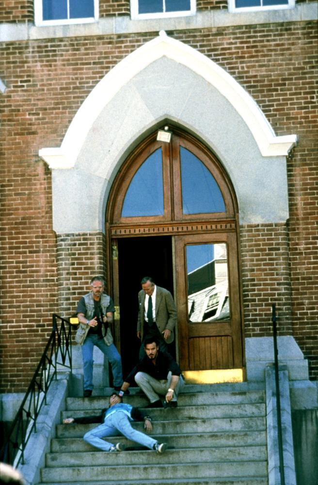 TOY SOLDIERS, Michael Champion (in vest), Denholm Elliott (in necktie), Andrew Divoff (seated), Wil Wheaton (lying down), 1991, (c) TriStar