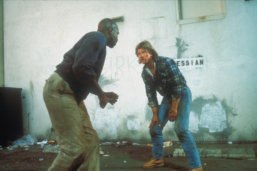 THEY LIVE, Keith David, Roddy Piper, 1988, ©Universal