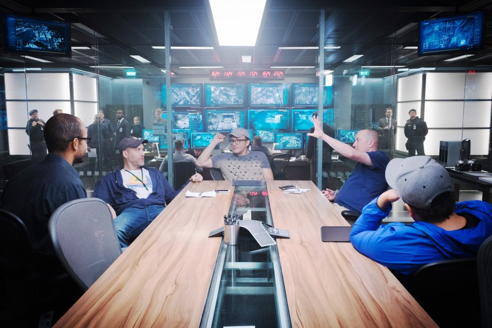 CAPTAIN AMERICA: CIVIL WAR, foreground from left: executive producer Nate Moore, screenwriter Stephen McFeely, director Anthony Russo, screenwriter Christopher Markus, director Joe Russo, on set, 2016. ph: Zade Rosenthal/TM & © 2016 Marvel. All rights reserved./© Walt Disney Studios Motion Pictures