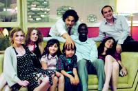 TELLEMENT PROCHES, Isabelle Carre (left), Josephine de Meaux (second from left), Vincent Elbaz (back center), Omar Sy (third from left), Audrey Dana (right, on couch), Francois-Xavier Demaison (right), 2009. ©Mars Distribution