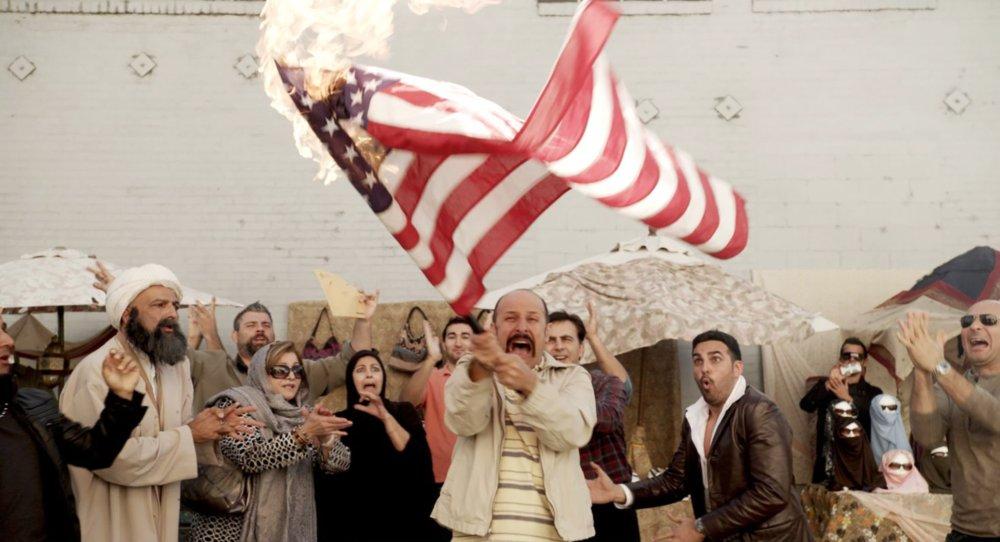 JIMMY VESTVOOD: AMERIKAN HERO, Maz Jobrani (holding flag), 2016