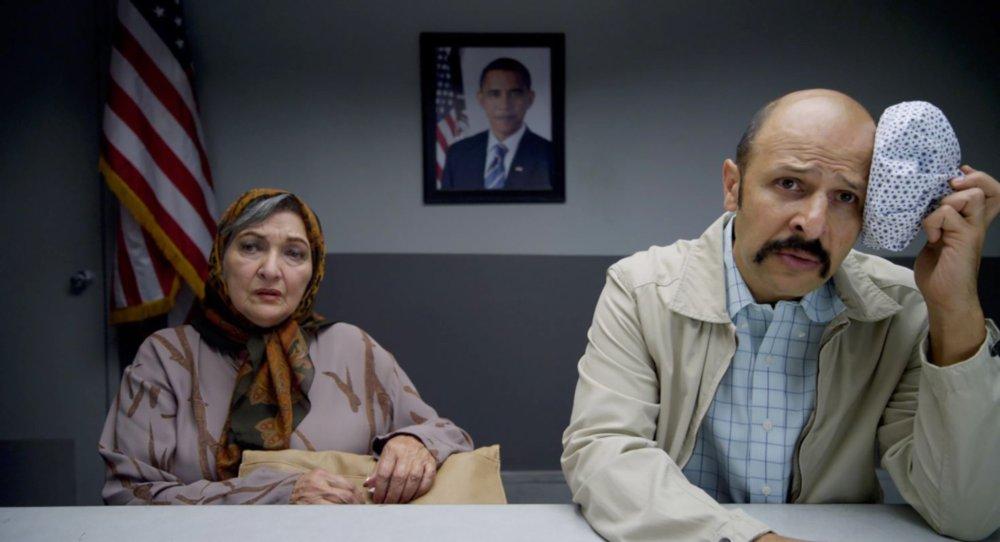 JIMMY VESTVOOD: AMERIKAN HERO, from left: Vida Ghahremani, Maz Jobrani, on wall: President Barack Obama, 2016