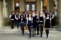 ST. TRINIAN'S, fourth from left, blonde, partially obscured: Juno Temple; foreground from goth girl in red stockings: Paloma Faith, Kathryn Drysdale, Talulah Riley, Lily Cole, Antonia Bernath, Tamsin Egerton, Amara Karan, 2007. ©NeoClassics Films