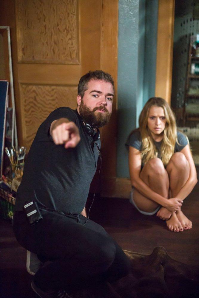 LIGHTS OUT, from left:   director David F. Sandberg, Teresa Palmer, on set, 2016. ph: Ron Batzdorff/© Warner Bros.