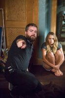 LIGHTS OUT, from left:   director David F. Sandberg, Teresa Palmer, on set, 2016. ph: Ron Batzdorff/© Warner Bros.