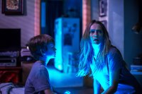 LIGHTS OUT, from left: Gabriel Bateman, Teresa Palmer, 2016. ph: Ron Batzdorff/© Warner Bros.