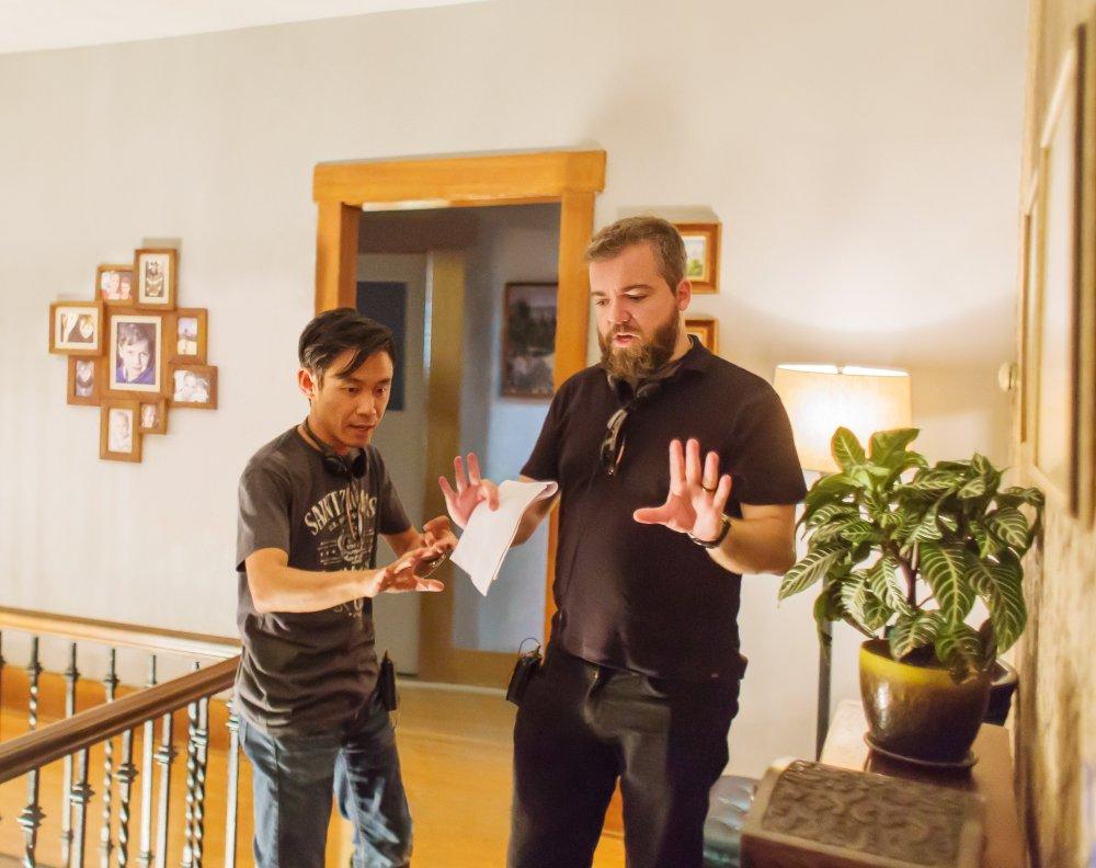 LIGHTS OUT, from left: producer James Wan, director David Sandberg, on set, 2016. ph: Ron Batzdorff/© Warner Bros.