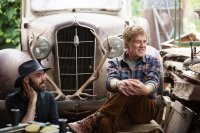 PETE'S DRAGON, from left: director David Lowery, Robert Redford, on set, 2016. ph: Matt Klitscher/© Walt Disney Studios Motion Pictures