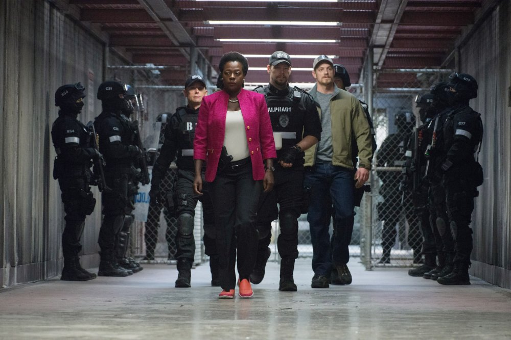 SUICIDE SQUAD, Viola Davis (front), Ike Barinholtz (center), Joel Kinnaman (green jacket), 2016. ph: Clay Enos/© Warner Bros.