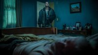 DON'T BREATHE, Stephen Lang (lying in bed), Daniel Zovatto (standing), 2016. ph: Gordon Timpen/© Screen Gems