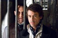 SHERLOCK HOLMES, from left: Mark Strong, Robert Downey Jr., 2009. Ph: Alex Bailey/©Warner Bros.