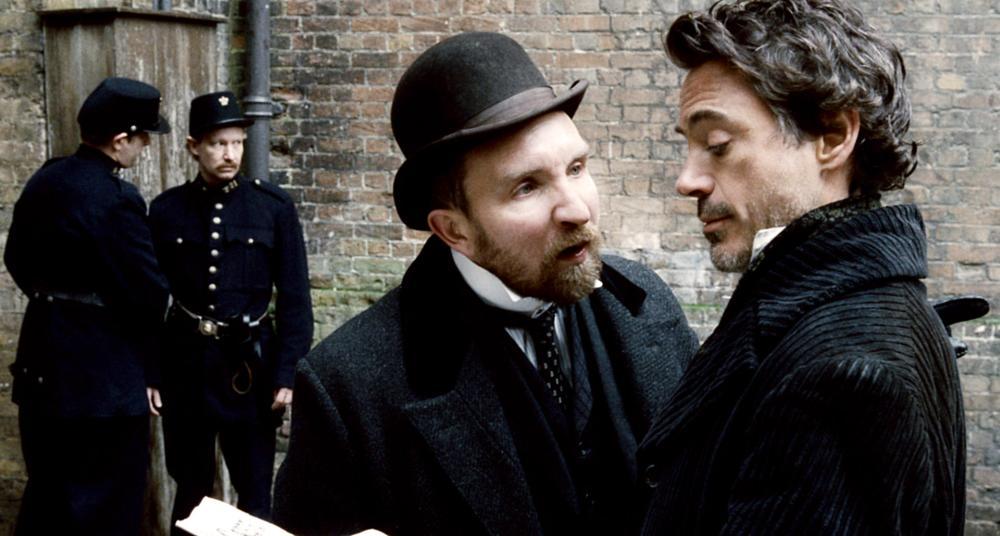 SHERLOCK HOLMES, front, from left: Eddie Marsan, Robert Downey Jr., 2009. ©Warner Bros.