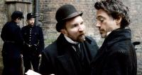 SHERLOCK HOLMES, front, from left: Eddie Marsan, Robert Downey Jr., 2009. ©Warner Bros.