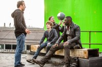 THE DARK TOWER, foreground from left: director Nikolaj Arcel, Tom Taylor, Idris Elba, on set, 2017. ph: Ilze Kitshoff/© Columbia Pictures