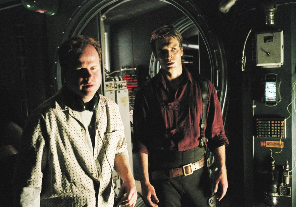 SERENITY, director Joss Whedon, Nathan Fillion, on set, 2005. ©Universal