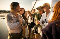 Left to right: Mark Wahlberg, Laura Haddock and Director/Executive Producer Michael Bay on the set of TRANSFORMERS: THE LAST KNIGHT, from Paramount Pictures.