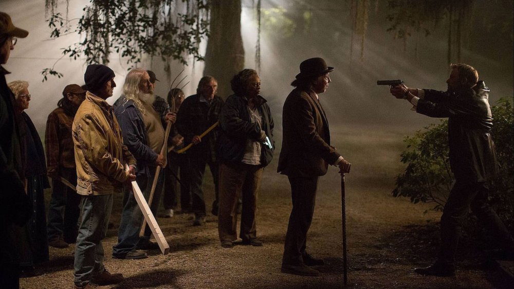 ABATTOIR, Dayton Callie (with cane), Joe Anderson (holding gun), 2016,  ©Momentum Pictures