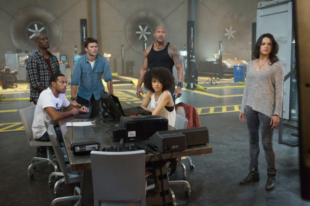 FAST & FURIOUS 8, (AKA THE FATE OF THE FURIOUS), FROM LEFT, TYRESE GIBSON, LUDACRIS, SCOTT EASTWOOD, DWAYNE JOHNSON, NATHALIE EMMANUEL, MICHELLE RODRIGUEZ, 2017. PH: MATT KENNEDY. ©UNIVERSAL STUDIOS