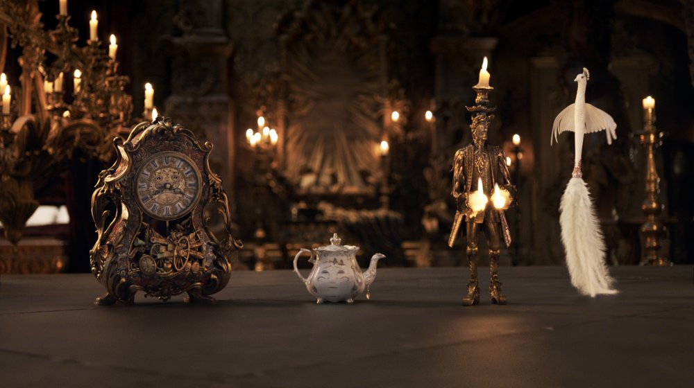 BEAUTY AND THE BEAST, FROM LEFT: COGSWORTH (VOICE: IAN MCKELLEN), MRS. POTTS (VOICE: EMMA THOMPSON), LUMIERE (VOICE: EWAN MCGREGOR), PLUMETTE (VOICE: GUGU MBATHA-RAW), 2017. © WALT DISNEY PICTURES