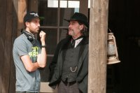 IN A VALLEY OF VIOLENCE, FROM LEFT: DIRECTOR TI WEST, JOHN TRAVOLTA, ON SET, 2016. PH: URSULA COYOTE/© FOCUS FEATURES