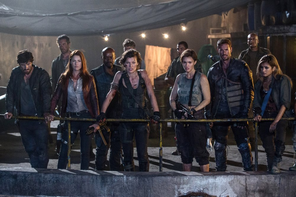 RESIDENT EVIL: THE FINAL CHAPTER, L-R: EOIN MACKEN, ALI LARTER, FRASER JAMES, MILLA JOVOVICH, RUBY ROSE, WILLIAM LEVY, ROLA, 2016. PH: ILZE KITSHOFF/©SCREEN GEMS