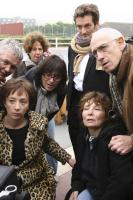 SAGAN, clockwise from lower left: Sylvie Testud as Francoise Sagan (leopard skin coat), Pierre Palmade (top), cinematographer Michel Abramowicz (glasses and dangling viewfinder), writer/director Diane Kurys (lower right), on set, 2008. ©Europa Corp