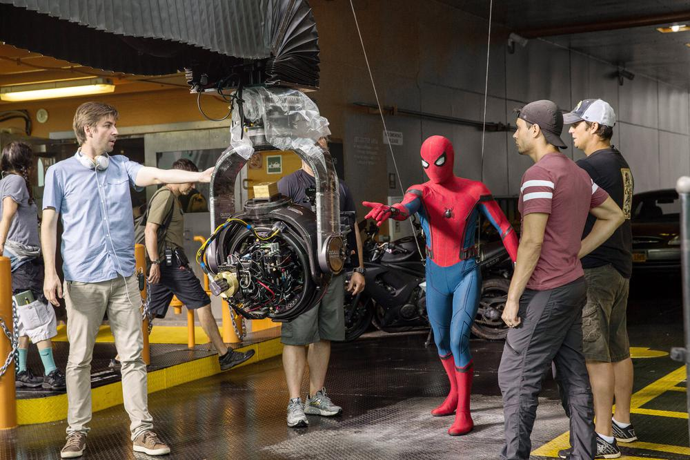 SPIDER-MAN: HOMECOMING, FROM LEFT, DIRECTOR JON WATTS,  TOM HOLLAND, ON-SET, 2017. PH: CHUCK ZLOTNICK. ©COLUMBIA PICTURES