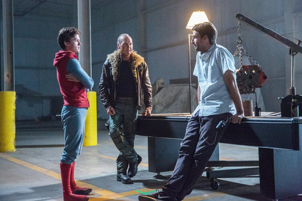 SPIDER-MAN: HOMECOMING, FROM LEFT, TOM HOLLAND, MICHAEL KEATON, DIRECTOR JON WATTS, ON-SET, 2017. PH: CHUCK ZLOTNICK. ©COLUMBIA PICTURES
