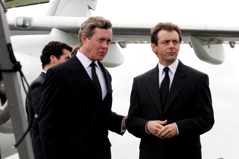THE QUEEN, Alex Jennings as Prince Charles, Michael Sheen as Prime Minister Tony Blair, 2006, © Miramax/courtesy Everett
