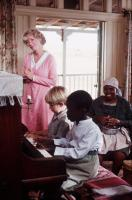 THE POWER OF ONE, Tracy Brooks Swope (standing), at piano from left: Guy Witcher, Tonderai Masenda, Nomadlozi Kubheka (right), 1992, © Warner Brothers