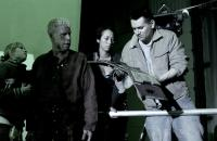 MUTANT CHRONICLES, Ron Perlman (second from left), director Simon Hunter (right), on set, 2008. ©Magnolia Pictures