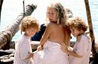 THE MOSQUITO COAST, Helen Mirren (center), with twins Hilary Gordon, Rebecca Gordon, 1986. ©Warner Bros.