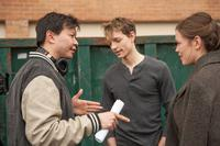 THE GRIEF OF OTHERS, FROM LEFT: DIRECTOR PATRICK WANG, MIKE FAIST, SONYA HARUM ON SET, 2018. PH: DON HAMILTON/© IN THE FAMILY