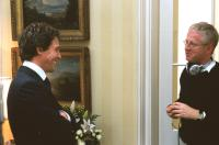 LOVE ACTUALLY, Hugh Grant, director Richard Curtis on the set, 2003, (c) Universal