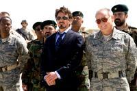IRON MAN, foreground: Robert Downey Jr. (center), Bill Smitrovich (far right), 2008. ©Paramount