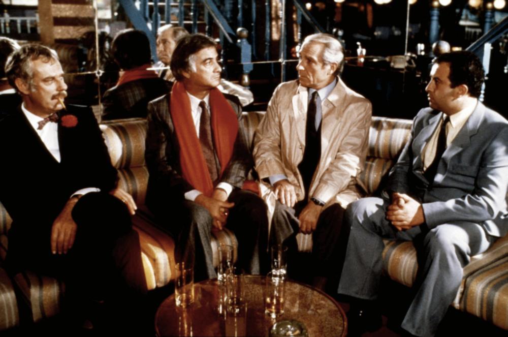 INSPECTEUR LAVARDIN, from left: Jean-Luc Bideau, Jean-Claude Brialy, Jean Poiret, Pierre-Francois Dumeniaud, 1986. ©MK2 Diffusion