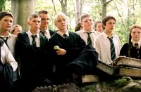 HARRY POTTER AND THE PRISONER OF AZKABAN, Joshua Herdman (third from left), Tom Felton (center, holding apple), Jamie Waylett (third from right), 2004, © Warner Brothers