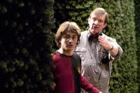 HARRY POTTER AND THE GOBLET OF FIRE, Daniel Radcliffe, director Mike Newell on set, 2005, (c) Warner Brothers